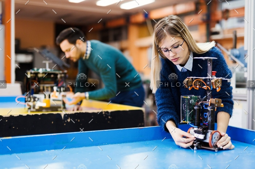 demo-attachment-60-young-student-of-robotics-working-on-project-S32GWUC